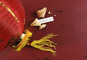 Happy New Year Message Greeting Inside Chinese New Year Fortune Cookie On Red Recycled Wood Backgrou