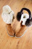 Winter Boots, Hat And Fur Headphones On The Floor Vertical