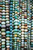foto of beads  - Collection of stone beads jewelry in a market - JPG