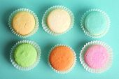 Set of gentle colorful macaroons on color background