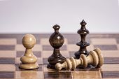 Chess pieces on an old chessboard