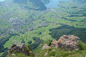 Schwytz City And Lake In Valley.