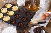 Cooking Chocolate And Vanilla Cupcakes Top View Horizontal