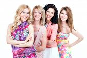 Group young beautiful smiling women in pink dresses - isolated on white.
