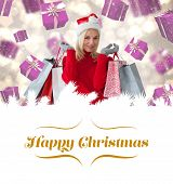 happy festive blonde with shopping bags against border