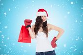 Beauty brunette in boxing gloves with shopping bag against blue vignette