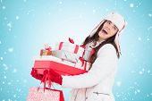 Brunette in winter clothes holding many gifts and shopping bags against blue vignette