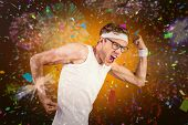 Geeky hipster posing in sportswear against white fireworks exploding on black background