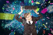 Young geeky businessman holding briefcase against colourful fireworks exploding on black background