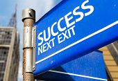 Success Next Exit blue road sign