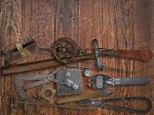 picture of work bench  - vintage jeweler tools and diamonds over wooden working bench space for text