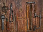 Vintage Jeweler Tools Over Wooden Wall