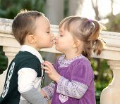 Girl And Boy Kissing Tenderly In The Park