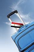 Destination Syria. Blue Suitcase With Flag.