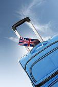 Destination United Kingdom. Blue Suitcase With Flag.