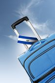Destination El Salvador. Blue Suitcase With Flag.