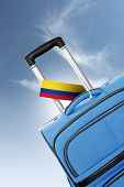 Destination Colombia. Blue Suitcase With Flag.