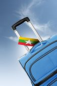 Destination Burma. Blue Suitcase With Flag.