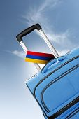 Destination Armenia. Blue Suitcase With Flag.