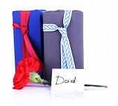 Two gift boxes with red carnation and card for Dad isolated on white background