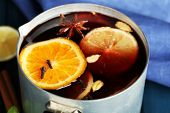Old metal pan of tasty mulled wine