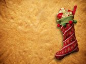 Christmas sock with red gift box on paper background