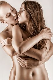 pic of enamored  - Two beautiful sexy lesbian women in erotic foreplay game on dark background - JPG