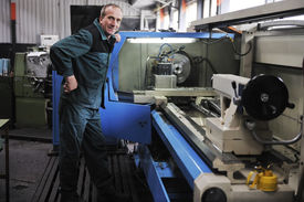 picture of mechanical engineer  - engineering people manufracturing industry with big modern computer machines  - JPG