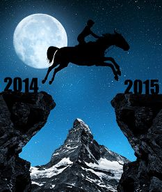 foto of year horse  - The rider on the horse jumping into the New Year 2015 - JPG