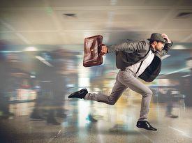 stock photo of running-late  - Tourist runs late to the flight departure - JPG