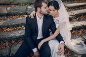 foto of yellow castle  - beautiful stylish elegant charming loving couple in the castle - JPG