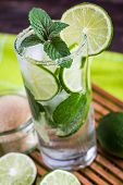 stock photo of tilt  - Mojito Lime Alcoholic Drink Cocktail Tilted View - JPG