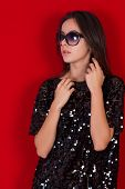 pic of little black dress  - Beautiful brunette girl in a black dress and glasses - JPG