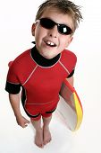 image of waterspout  - a child dressed in wetsuit and holding a board is ready for the beach - JPG