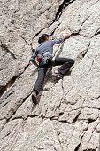 foto of climbing wall  - Young woman climbing difficult wall rock climbing in polish mountains - JPG