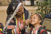 stock photo of rajasthani  - Young Rajasthani dancer gets ready to perform at the Sarujkund Fair near Delhi in India - JPG