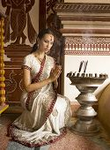 picture of indian sari  - Beautiful young indian woman in traditional clothing with incense bridal makeup and oriental jewelry - JPG