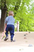 stock photo of climbing wall  - child climbs up the wall in the park - JPG