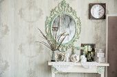 stock photo of mirror  - Vintage interior with mirror and a table with a vase and willows - JPG