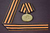 stock photo of victory  - Soviet military medal in honor of a victory in war against Germany 1941 - JPG