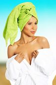 picture of undressing  - Beautiful woman undressing her bathrobe - JPG