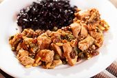 stock photo of wild turkey  - Turkey with capers and raisins over wild rice - JPG