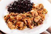 stock photo of wild turkey  - Turkey with capers and raisins over wild rice - JPG