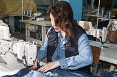 image of sewing  - Industrial sewing machines sewing machine operator with chain - JPG