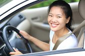picture of seatbelt  - young asian woman driver driving a car - JPG