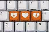 stock photo of hookup  - Online Dating A gray computer keyboard with man and woman symbol with a heart in orange letters - JPG