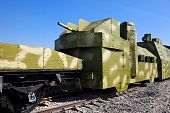 stock photo of armored car  - powerful armored train against the blue sky - JPG