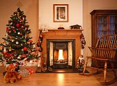 stock photo of cozy hearth  - Traditional living room with a cosy open fire adorned with christmas decorations and a tree - JPG