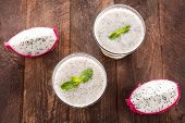 stock photo of dragon fruit  - Top dragon fruit smoothie on wooden table - JPG