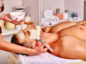 picture of beauty parlour  - Man with clay facial mask in beauty spa - JPG